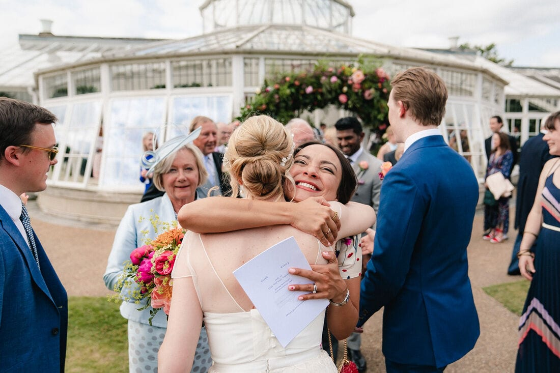 friends and family congratulate the newlyweds at chiswick house