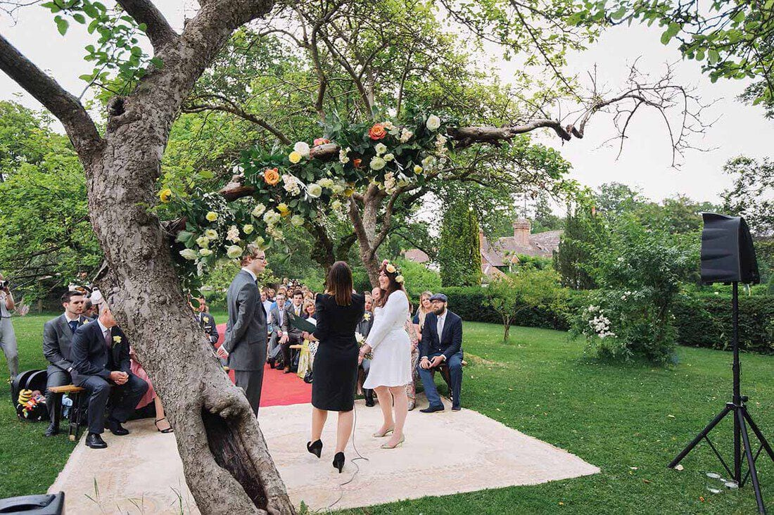 a wonderful outdoor wedding ceremony in an apple orchard