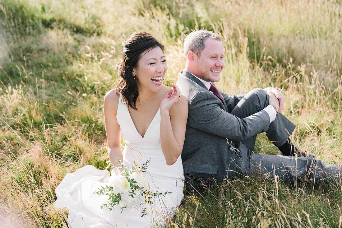 a relaxed wedding portrait in the evening sunshine