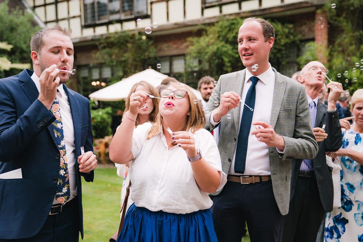 wedding guests enjoying the reception bubbles