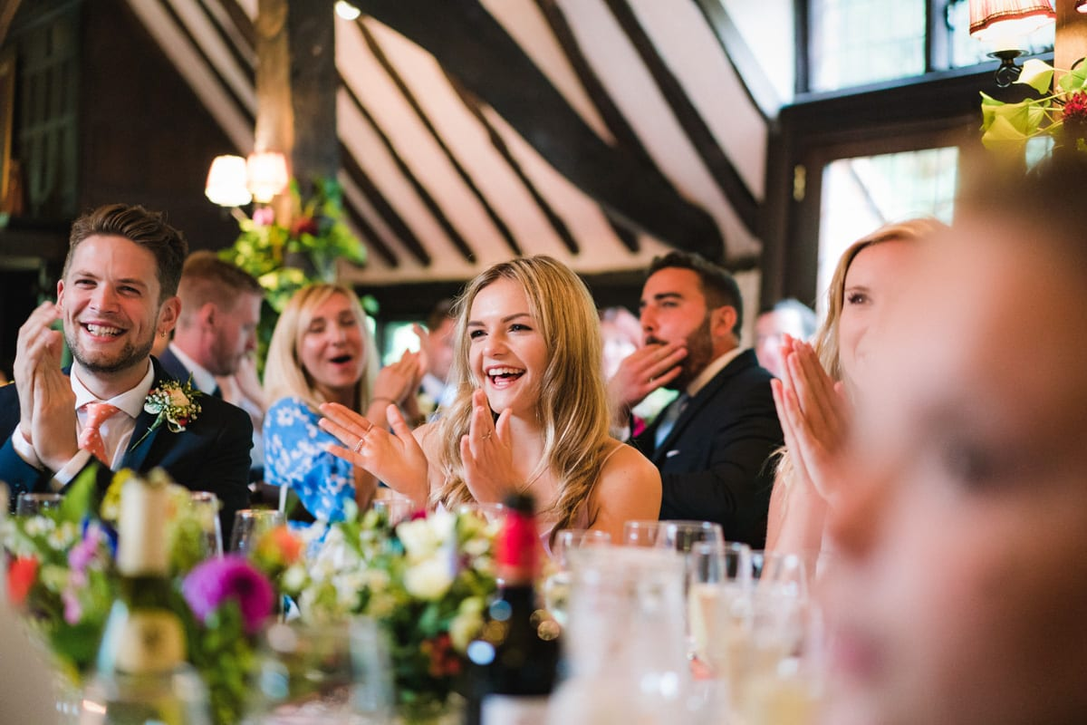 reaction shot of wedding guests enjoying the father of the bride speech