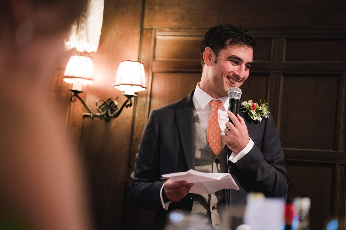 the groom gives his speech recorded in their wedding video