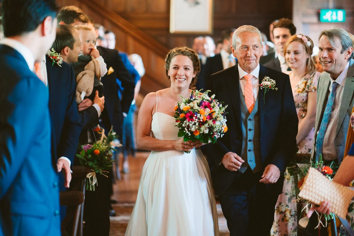 a moving moment as the bride enters the wedding ceremony with her father