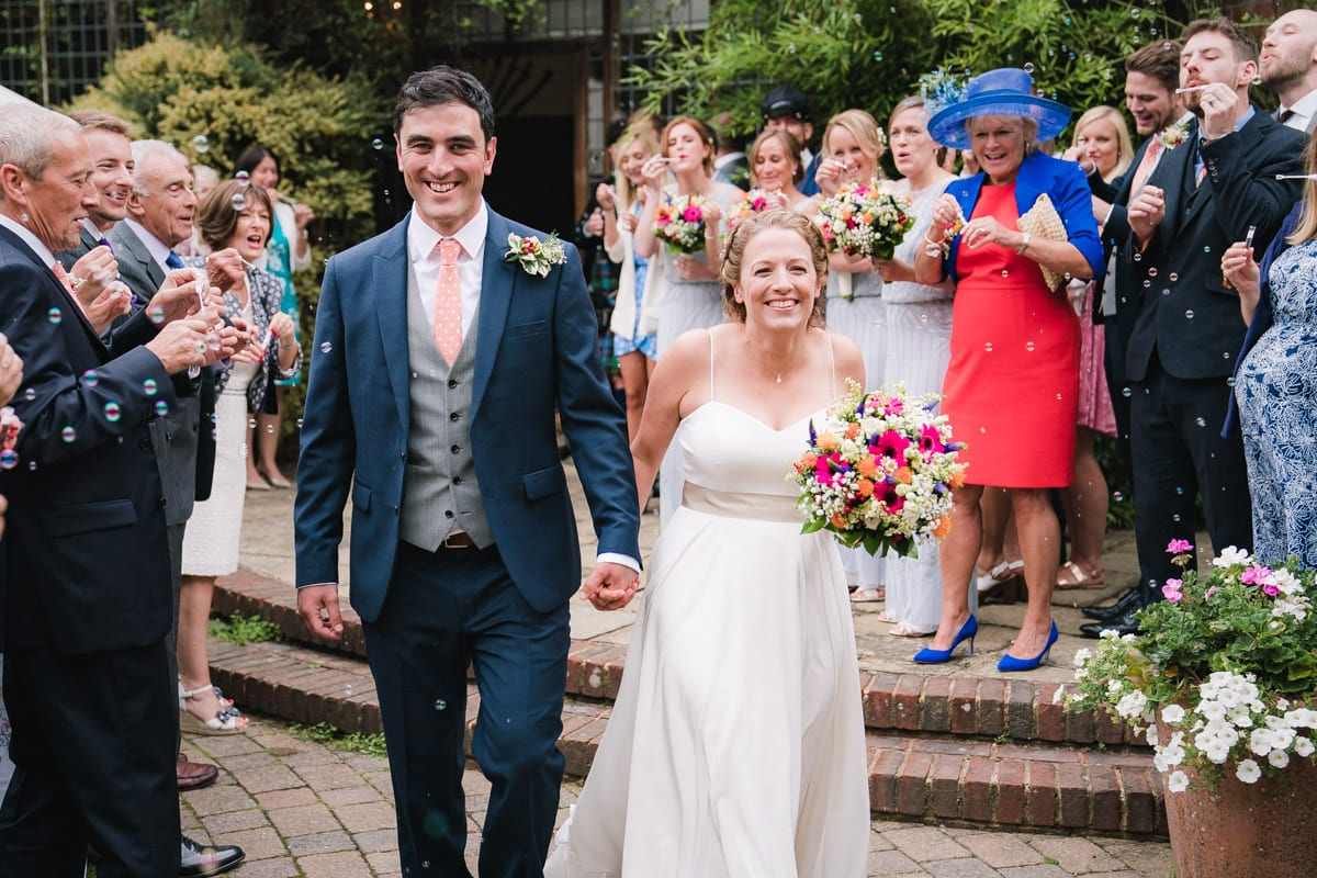 wedding confetti bubbles captured on video and photo at Ramster Hall in Surrey