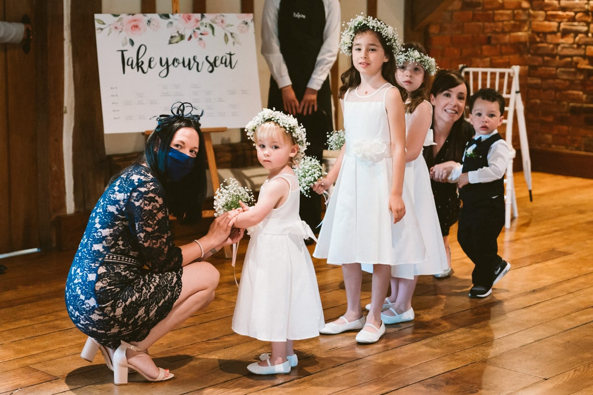 I love photographing such adorable reactions as these when the flower girls say the bride for the first time at Cain Manor