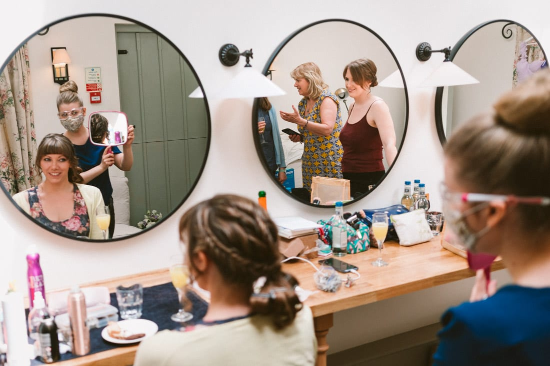 the bride and bridesmaids getting ready at Gate Street Barn