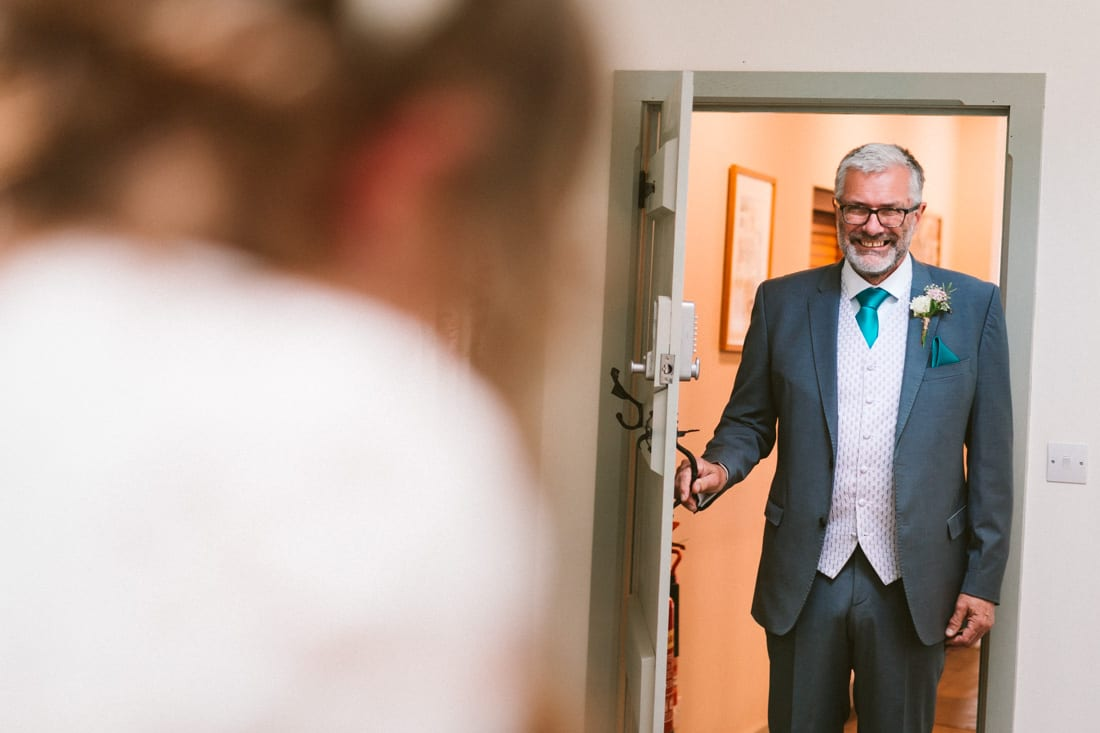 I love photographing the father of the bride's reaction