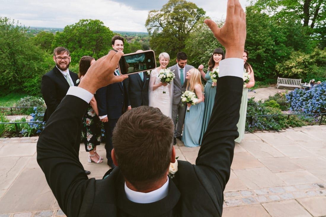 Father of the bride tries to organise the family photos