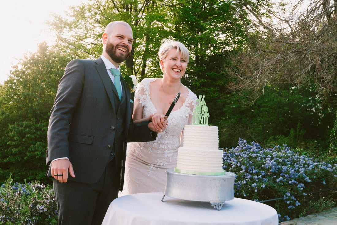 The couple cut the wedding cake at their pembroke lodge wedding